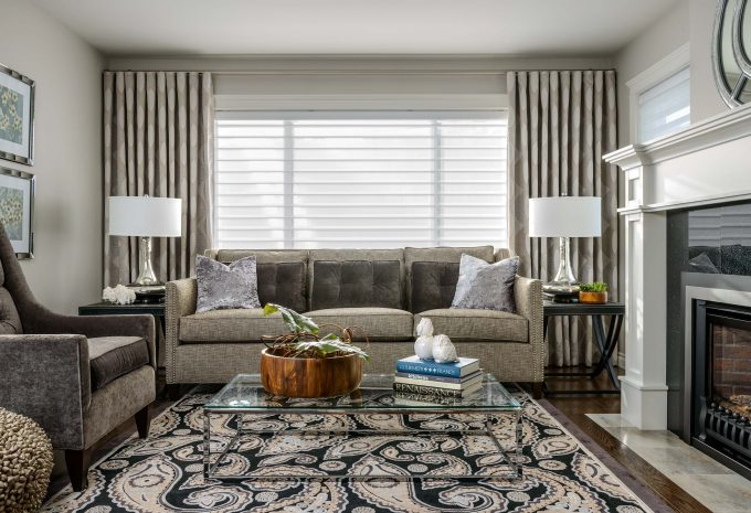 Contemporary Living Room Plus Chrome Coffee Table With Glass Top Also Fireplace Plus Mantel And Silver Table Lamps On Side Table With Hunter Douglas Blinds Plus Tan Sofa And Velvet Armchair
