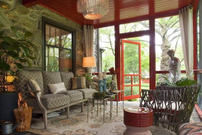 Contemporary Porch With Area Rug Plus Nesting Coffee Table And Patterned Sofa Also Decorative Pillows With Ceiling Light On Red Tongue And Groove Ceiling Also Door In Sun Porch