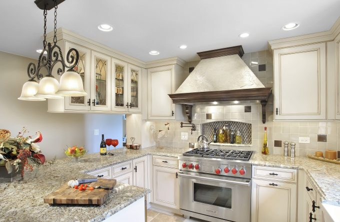 Copper Range Hoods With Pot Filler And Paint Kitchen Cabinets In Traditional Kitchen With Under Cabinet Lighting And Granite Countertop Plus Ceiling Lights Also Linear Chandelier