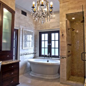 Crystal Chandelier In Master Bathroom Also Free Free Standing Bath Tubs For Glamorous Bathroom With Glass Mosaic Shower Wall And Houston Bathroom Design For Master Bathroom Remodel With Travertine Tile Flooring