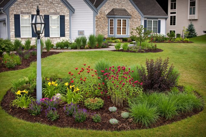 Curb Appeal And Garden Ideas With Landscape Design Also Bee Balm Plus Blue Shutters And Stone Starck For Exterior Ideas Plus Flower Bed Also Fountain Grass In Front Yard For Stone House
