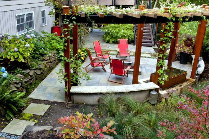 Curved Garden Wall Plus Fire Pit And Flagstone Also Folding Chairs With Hydrangea For Pergola Ideas Also Rain Garden Plus Tall Grasses With Water Feature And Climbing Plants On Arbour