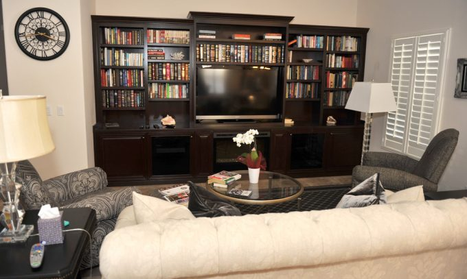 Custom Entertainment Centers With Creative Bookshelves And Rome Clock In Traditional Family Room With Floor Lamp And Modern Sofa Plus Round Glass Table Also Armchairs