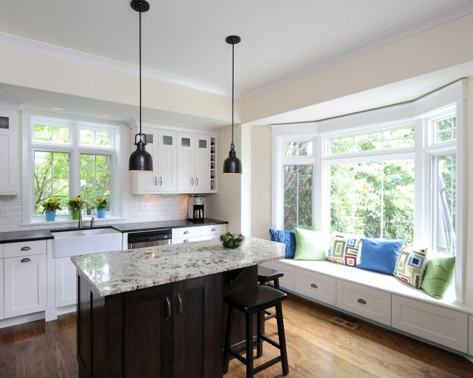 Custom Kitchen Islands With Marble Countertop And Kitchen Bar Stools In Traditional Kitchen With Pendant Lighting And White Kitchen Cabinets Plus Bay Window Seat Also Dark Wood Floor
