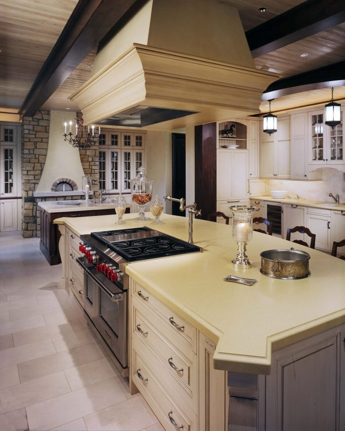 Custom Kitchen Islands With Pot Filler And Copper Range Hoods In Traditional Kitchen With Black Chandelier And Pendant Lighting Plus Sconces Also Laminate Tile Flooring