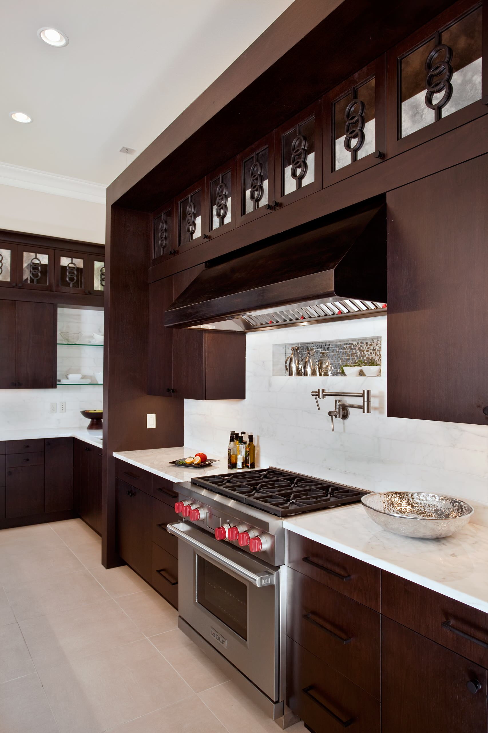 Pot Filler for Inspiring Water Instalation Ideas: Dark Kitchen Cabinets With Copper Range Hoods And Pot Filler For Contemporary Kitchen Design With Tile Backsplash And Gas Stove Plus Tile Flooring Also Ceiling Lights