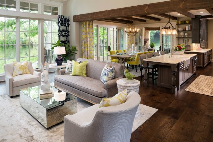 Dark Wood Kitchen Flooring With Exposed Wood Beams Plus Gray Sofa And Decorative Pillows In Great Room With Best Way To Clean Hardwood Floors Plus Mirrored Coffee Table And Transom Windows