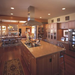 Decorating Kitchen With Almond Mauve Granite Countertop Plus Barstools For Breakfast Bar With Ceiling Lighting And Ceramic Tile That Looks Like Wood Plus Cherry Cabinets And Range Hood