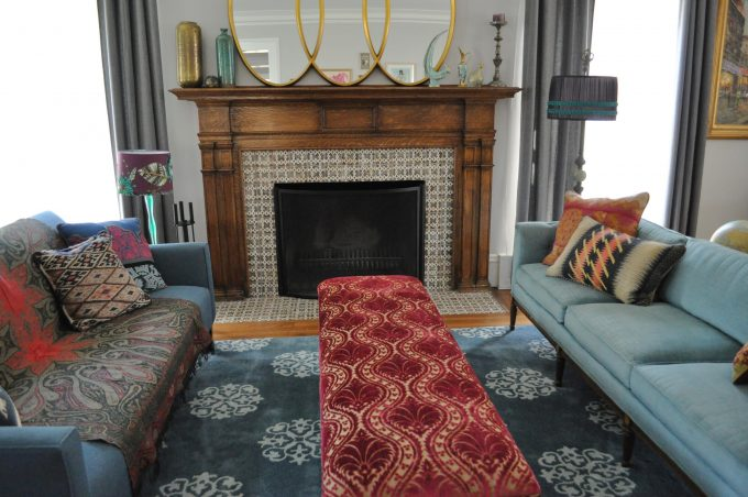 Decorative Pillows For Couches And Fireplace Mantles For Fireplace Screen Plus Mantel Decor With Mixed Patterns And Oval Mirror Also Rectangular Ottoman Table In Eclectic Living Room