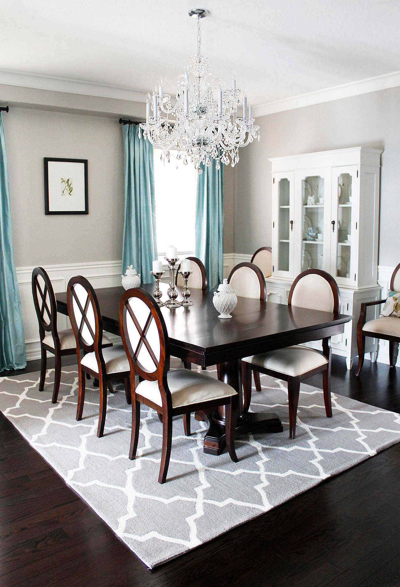Dining Room Chandelier With Dining Table Plus Upholstered Dining Chairs And Modern Rugs With Hardwood Floorin Also Hanging Curtains With Wainscoting