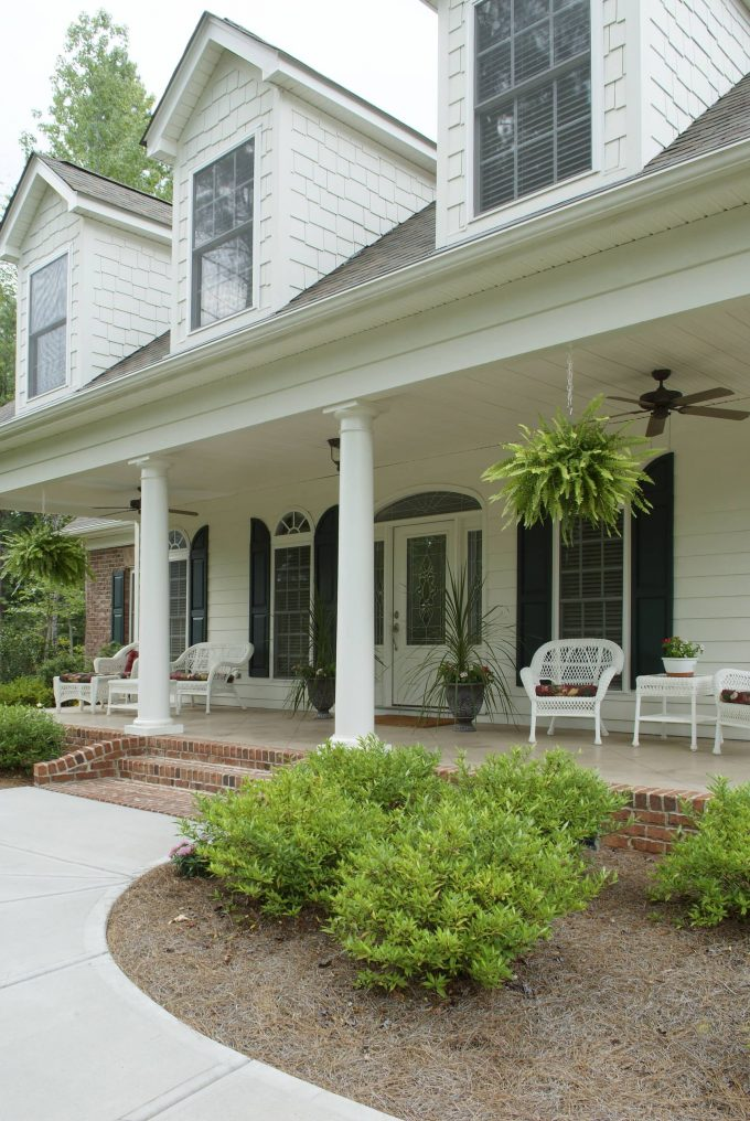 Dormer With Shingle Siding And Porches Plus Hanging Planter With Columns And Patio Furniture Also Front Entry Door With Sidelights And Window Shutters