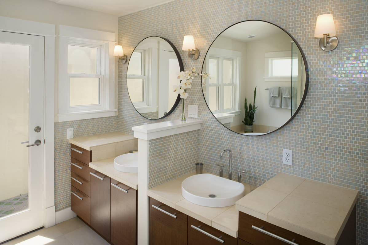 Double Sink Vanity With Vessel Sink Faucets And Mosaic Tile Wall In Contemporary Bathroom With Round Vanity Mirror And Wall Sconces Plus Modern Vanity Table Also Glass Door