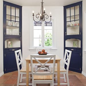 Eclectic Dining Room With Spanish Tile Flooring And Breakfast Nook Plus Casement Window Also Layout Chandelier With Corner China Cabinet In Dining Room Plus White Painted Trim