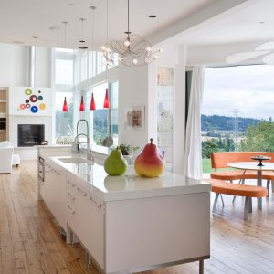 Engineered Wood Flooring For Contemporary Kitchen Plus Seating Area With Orange Furniture In Outdoor Plus Ceiling Fan And Round Table Also White Kitchen Island With Undermount Sink