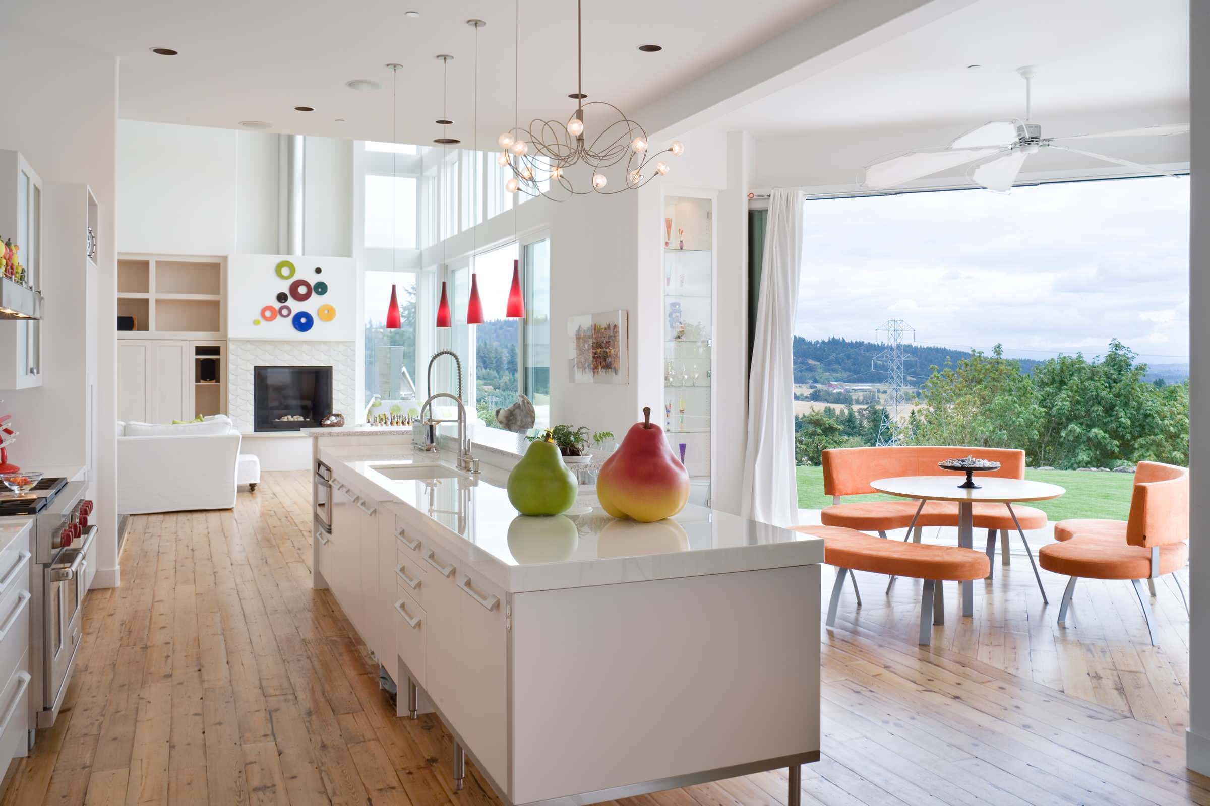 Inspiring Kitchen with Engineered Wood Flooring Ideas: Engineered Wood Flooring For Contemporary Kitchen Plus Seating Area With Orange Furniture In Outdoor Plus Ceiling Fan And Round Table Also White Kitchen Island With Undermount Sink