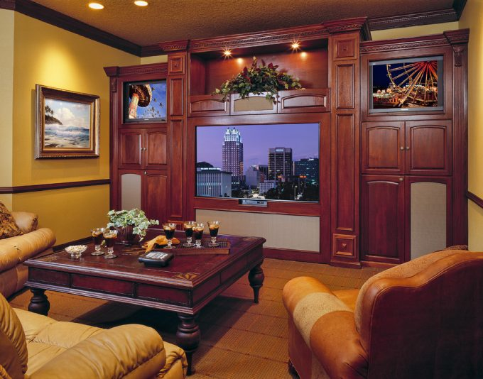 Fabrica Carpet With Brown Leather Sofa And Coffee Table In Traditional Living Room With Custom Entertainment Centers And Crown Moulding Plus Ceiling Lights Also Sconces