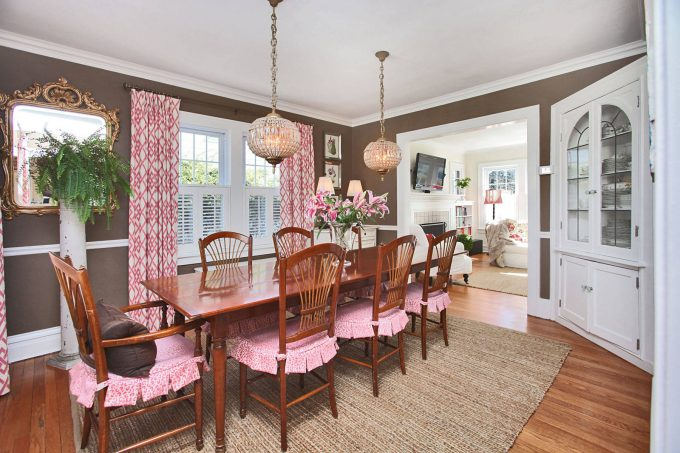 Fantastic Dining Room With Brown Wall Plus Colorful Accents And Corner China Cabinets With Globe Pendant Light And Jute Rug Plus Pink Curtains Also Pink Cushions With Pink Patterned Cushions