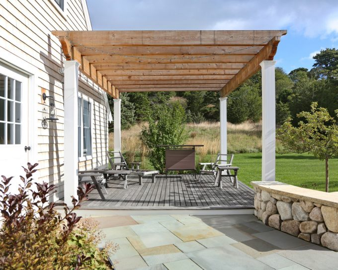 Farmhouse Deck With Attached Deck In Back Patio Plus Wood Chairs Also Wood Table With Bluestone Walkway For Pergola Ideas Plus Outdoor Living Space And String Lights With Wood Beams