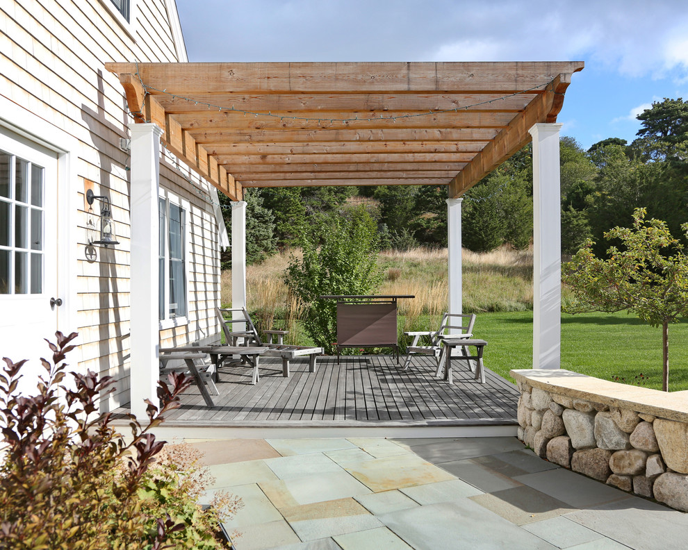 Inspiring Exterior House plus Pergola Ideas: Farmhouse Deck With Attached Deck In Back Patio Plus Wood Chairs Also Wood Table With Bluestone Walkway For Pergola Ideas Plus Outdoor Living Space And String Lights With Wood Beams