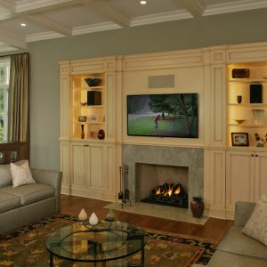 Fireplace Mantel With Custom Entertainment Centers And Coffered Ceiling In Traditional Living Room With Contemporary Curtain And Modern Sofa Plus Round Coffee Table Also Feizy Rug
