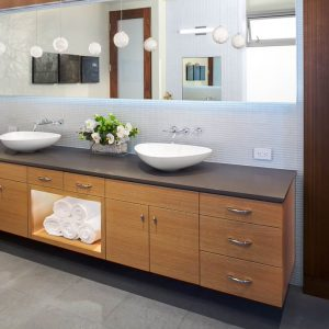 Floating Cabinets With Double Sink Vanity And Vessel Sink Faucets For Modern Bathroom Design With Rectangular Mirror And Recessed Lighting Plus Pendant Lighting Also Laminate Tile Flooring