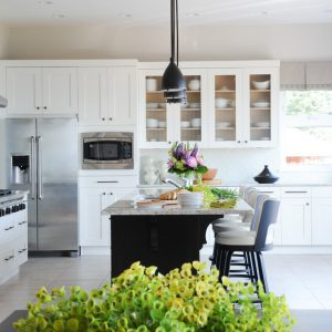 Fresh Kitchen With Box Pleated Valances Plus Bronze Hardware And Bronze Pendant Lights With Custom Glass Backsplash And Dark Island Plus Floral Arrangement Also Refacing Kitchen Cabinets