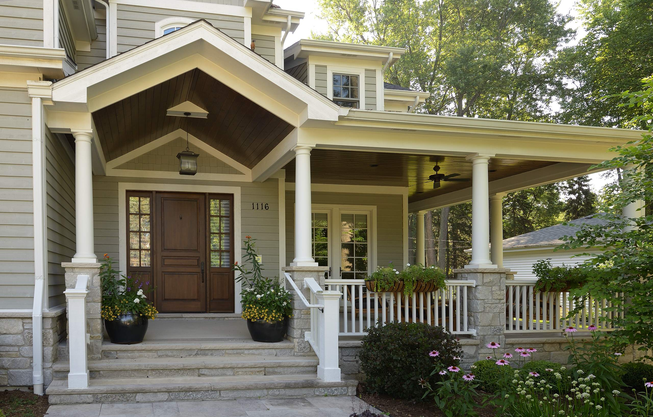10 Astounding Porches for Your Lovely Home: Front Stoop Design With Porches And Front Entry Door Also Sidelights With Wood Siding And Porch Lights Plus Railings And Flower Beds With Ceiling Fan