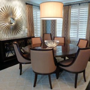 Glamour Dining Room Design With Sunburst Mirrors And Wallpaper Plus Drum Pendant Lighting With Round Dining Table And Upholstered Dining Chairs On Berber Carpet In Traditional Dining Room