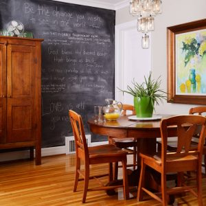 How To Make Chalkboard Paint With Wood Storage Cabinets And Crown Molding In Traditional Dining Room Design With Chandeliers And Round Dining Table Plus Wood Dining Chairs Also Wood Floor