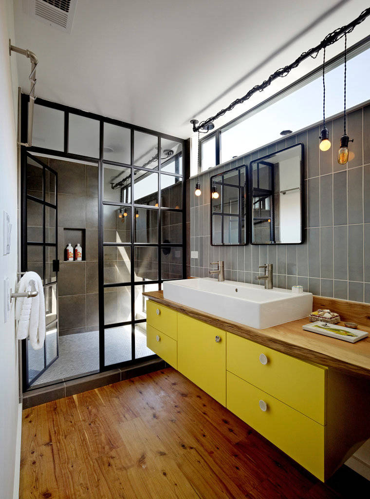 Remodel Bathroom Ideas Using Glass Shower Enclosures: Industrial Bathroom Plus Bare Bulb Pendants And Bathroom Mirror With Glass Shower Enclosures Plus Floating Vanity And Transom For Natural Daylight Also Walk In Shower With Towel Rack And Farm Sink