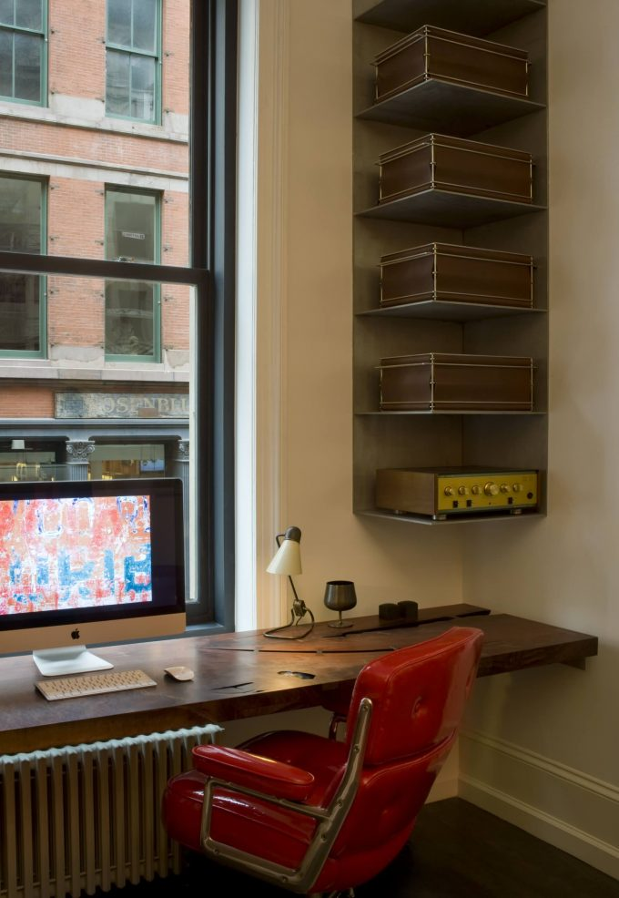 Industrial Home Office With Built In Desk Plus Armchair And Desk Lamp Also Corner Shelf Unit In Apartment With Red Swivel Chair And Wooden Desk For Work Space Also Storage
