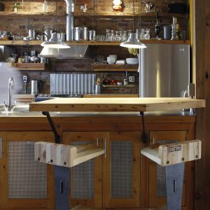 Industrial Kitchen With Breakfast Bar And Brick Walls Also Exposed Brick Plus Kitchen Island With Open Shelves And Pendant Lighting Plus Portable Bars Also Stainless Steel Appliances