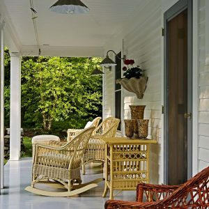 Industrial Pendant Lighting For Porch Lights And Wicker Furniture Also Outdoor Cushions And Shiplap Siding With Front Entry Door And Wall Scones For Porches