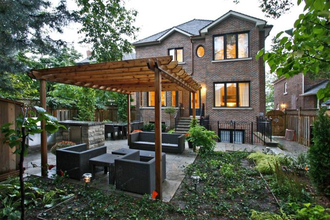 Inspiring Backyard With Brick House And Brick Wall Plus Covered Patio Also Outdoor Lounge With Patio Furniture For Pergola Ideas Plus Planter With Fence And Small Garden Design Ideas Also Wicker Furniture