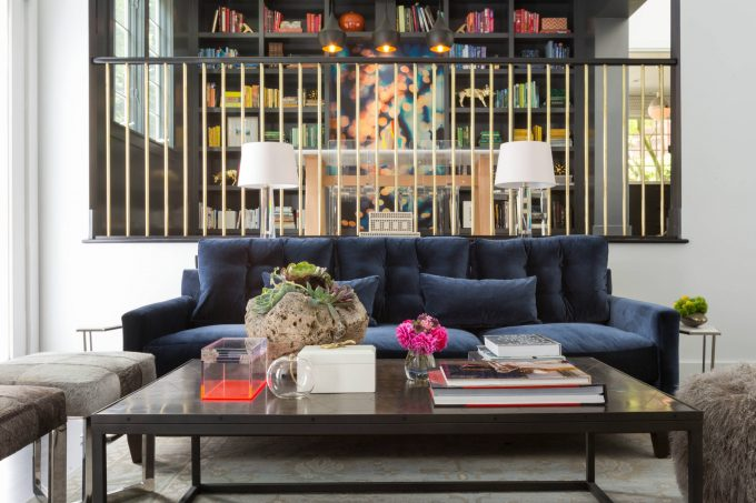 Inspiring Bookshelves With Railing Also Coffee Table Plus Fur Ottoman And Lucite Chairs With Pendant Light And Sunken Seating Area Also Tufted Sofa With Restorationhardware