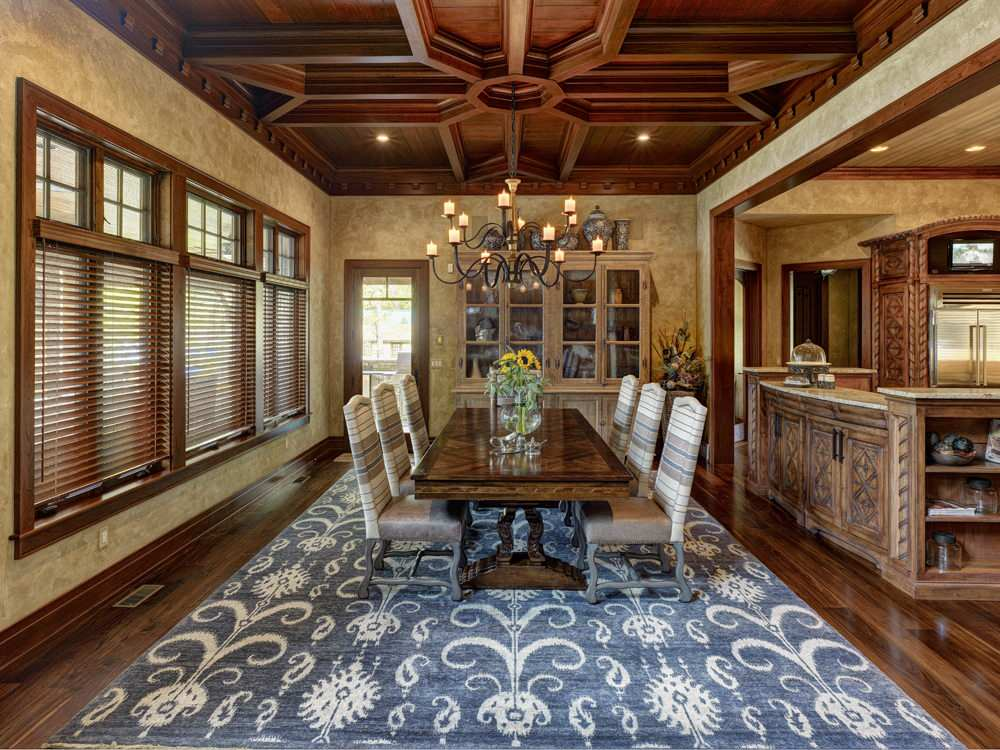 Inspiring Coffered Ceiling Plus Foyer Chandelier In Traditional Dining Room With Glass Door And Hardwood Flooring Plus Ikat Rug Also Long Dining Table With Upholstered Chairs Plus Wood Window Casing