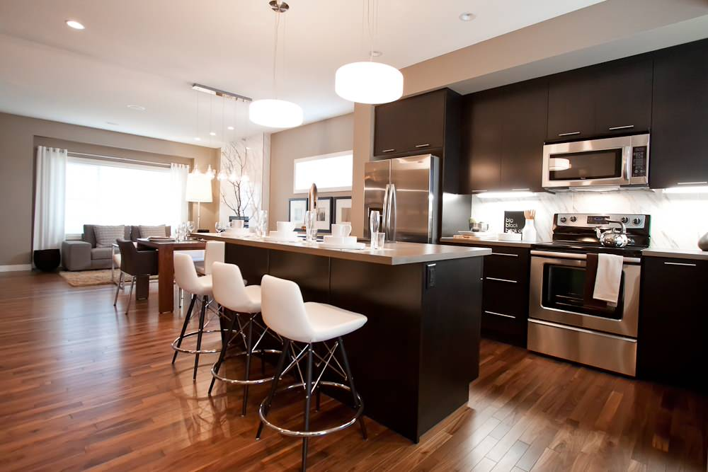 Inspiring Counter Stools And Dark Stained Cabinets For Dining Area With Gray Counters Plus Pendant Lights And Hardwood Floor Colors With Open Floor Plan Plus Area Rus And Window Treatment