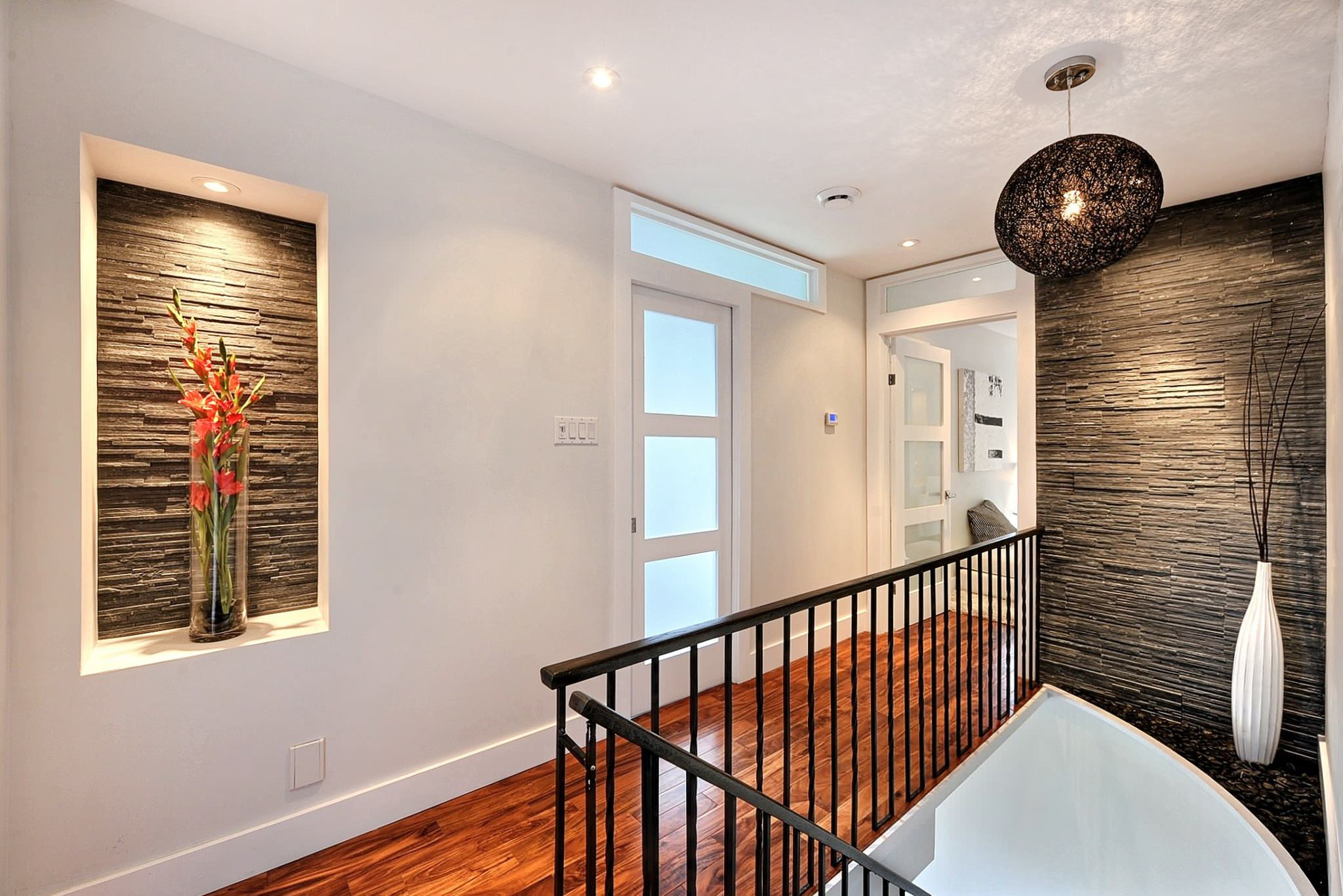 Inspiring Home Interior Using Modern Interior Doors: Inspiring Curved Wall And Gladiola Plus Large Vase Also Metal Spindles With Random Light And Staircase Also Stone Wall Plus Modern Interior Doors With Translucent Glass Door Also Transom
