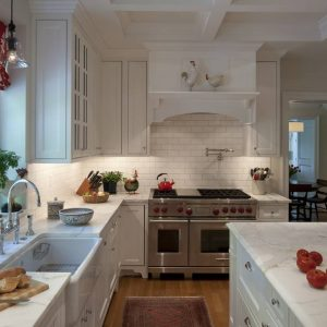 Kitchen Sink Faucet With Marble Countertop And White Kitchen Cabinets In Traditional Kitchen With Pot Filler And Coffered Ceiling Plus Drum Chandelier Also Roman Blinds