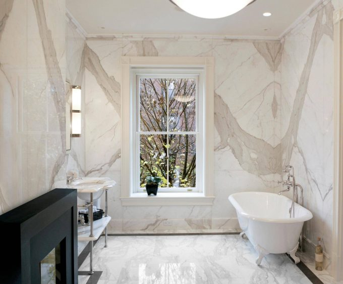 Marble Bathroom With Wall Sconce And Bathroom Vanity With Marble Countertop Also Claw Foot Tub And Window Trim With Recessed Lighting And Ceiling Lighting