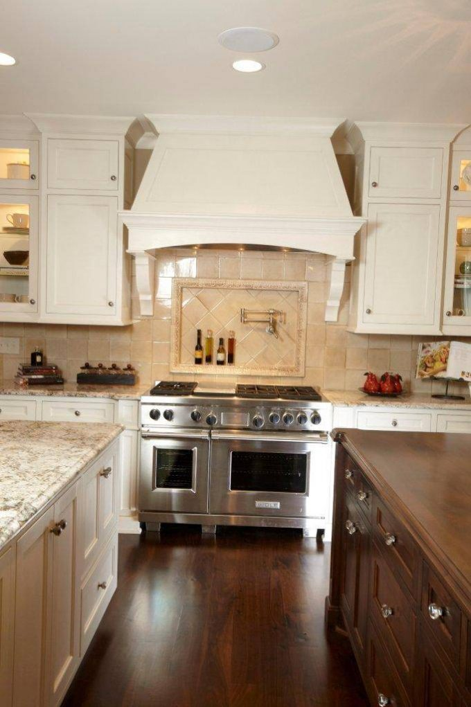 Marble Countertop With Kitchen Island And Kitchen Knobs For Traditional Kitchen Design With Dark Hardwood Floor And Tile Backsplash Plus Pot Filler Also Copper Range Hoods