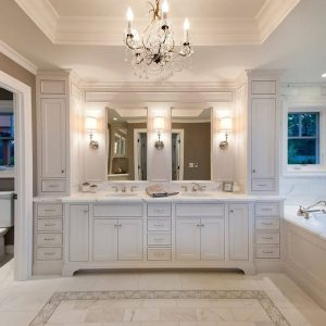 Master Bathroom Plus Crystal Chandelier And Custom Cabinet With Marble Flooring Plus Sconces And Bathroom Mirror Also Water Closet With Tile Wall And Recessed Lighting Plus Bathroom Storage