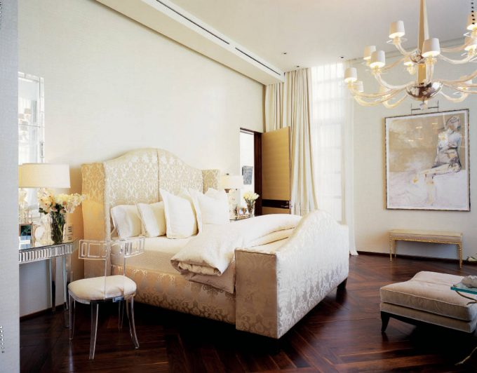 Master Bedroom With Chandelier Plus Chandelier Shades And Dark Wood Flooring With Herringbone Pattern Also Dressing Table And Lucite Chair Plus Mirrored Desk Also Wall Decor
