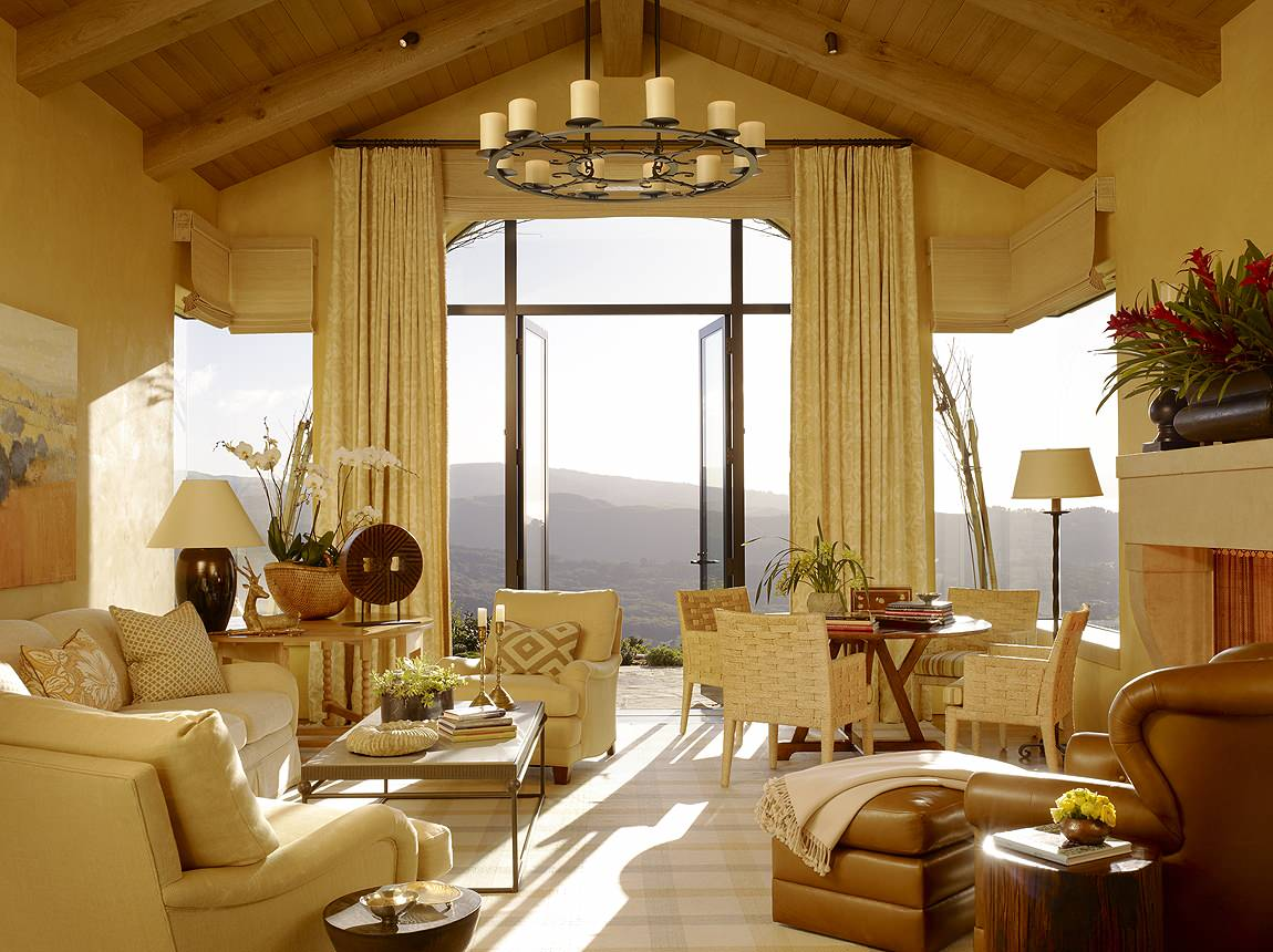 Inspiring Lighting for Living Room Using Floor Lamp Ideas: Mediterranean Living Room Plus Beige Couch And Decorative Pillows For Couches Also Floor Lamp With Corner Windows And Exposed Beams Also French Doors Plus Houseplants With Vaulted Ceiling