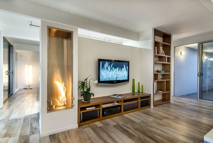 Midcentury Family Room Plus Fireplace Low And Bookcases Designs Also Media Unit With Wall Mount Tv And Ceramic Tile That Looks Like Wood Plus Houseplant Also Storage Ideas