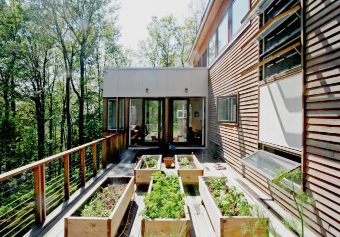 Modern Deck Plus Awning Windows And Cable Railing Also Edible Gardening With Planter Boxes And Raised Beds Also Raised Planters With Wood Siding Plus Windows Design Ideas