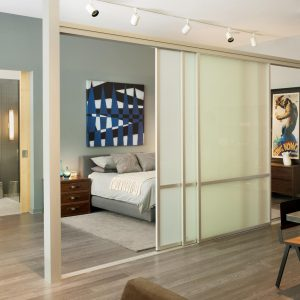 Modern Hall With Cheap Room Dividers And Bedroom Design Also Wood Flooring And Area Rug With Upholstered Bed Frame Plus Bedding With Bed Pillows And Nightstand
