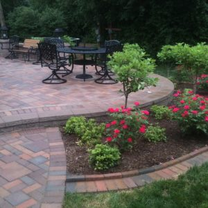 Patio Brick Pavers And Garden Patio Designs With Edge Brick In Traditional Patio Plus Dining Area And Wood Bench Also Lantern For Landscape Lighting With Flower Bed And Grass