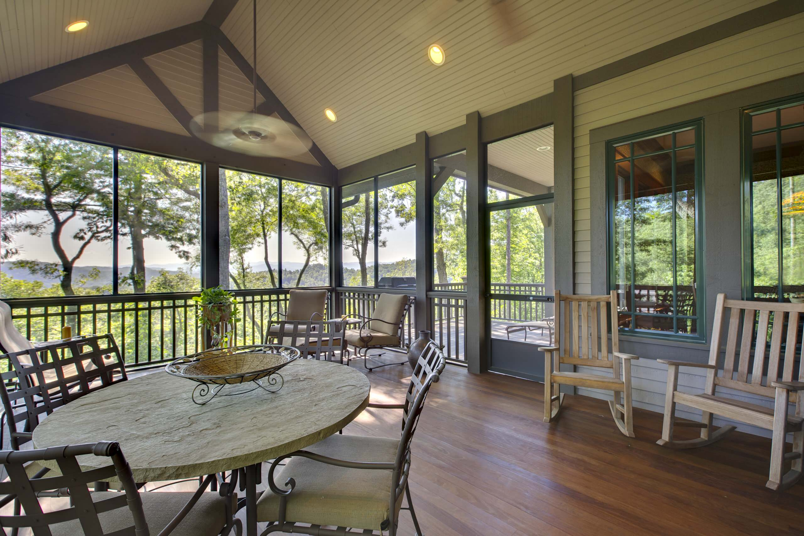 10 Astounding Porches for Your Lovely Home: Porch Railings With Outdoor Kitchen And Window Molding Also Shiplap Siding And Patio Furniture With Wood Flooring Plus Ceiling Fan With Recessed Lighting For Porches