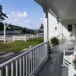 Porches With Patio Furniture And Wood Decks Also Porch Railings With Corbels And Ceilings Plus Exterior Lighting With Board And Batten Siding
